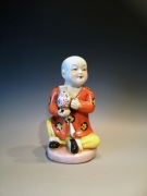 Schattig decoratie beeldje van een kindje met een vaas in de hand